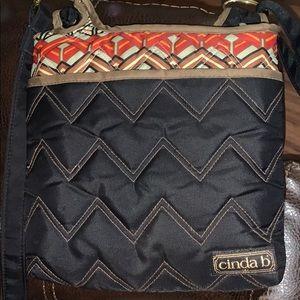 Cinda b happy crossbody purse